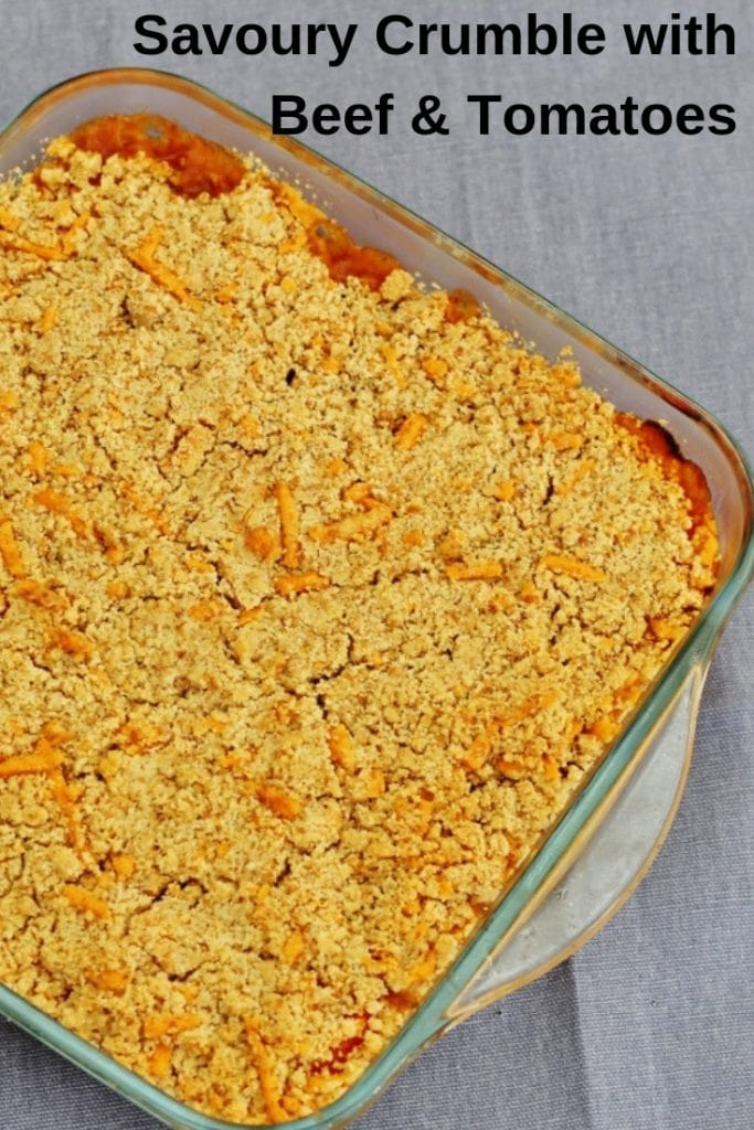 This savoury crumble with minced beef and tomatoes is an old favourite of mine. With a layer of minced beef covered with sliced tomatoes and topped with a cheesy crumble, it's easy to make and great for a midweek dinner.   Prepare it in advance then just bake in the oven before serving. #onepotmeal #mincedbeef #groundbeef #familyfood #mainmeal