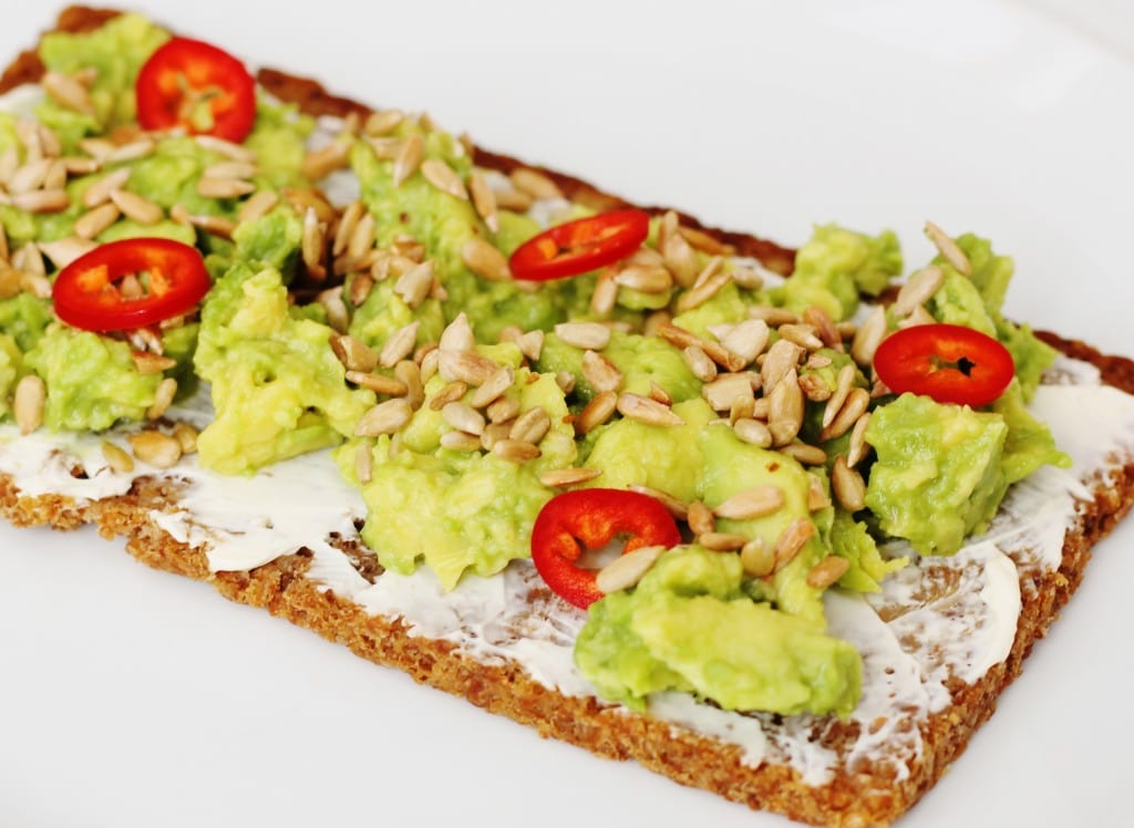 Jamie Oliver avocado sunflower seeds and sliced chillli peppers on rye bread