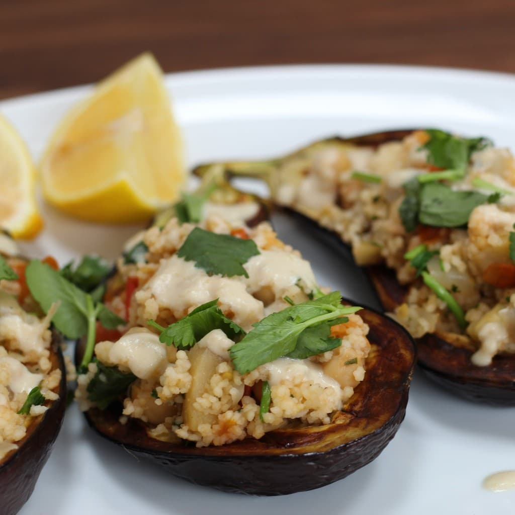 couscous stuffed aubergine with tahini sauce