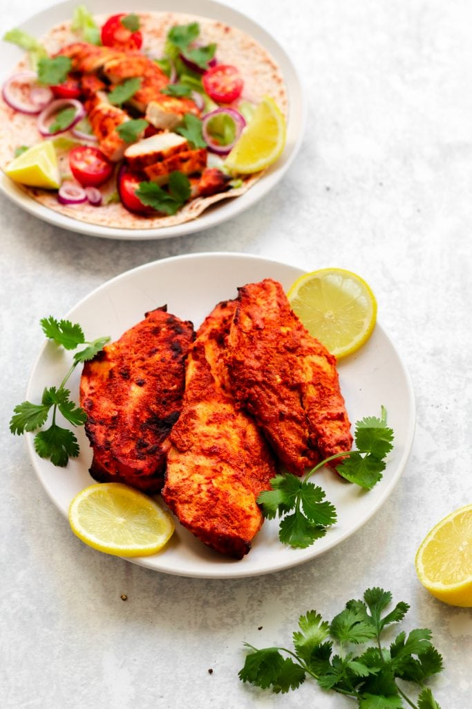 Chicken tikka with wrap in the background