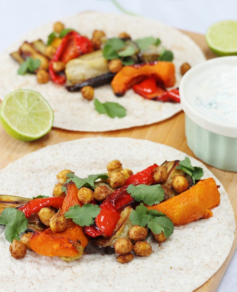 Spiced chickpea tacos on a board