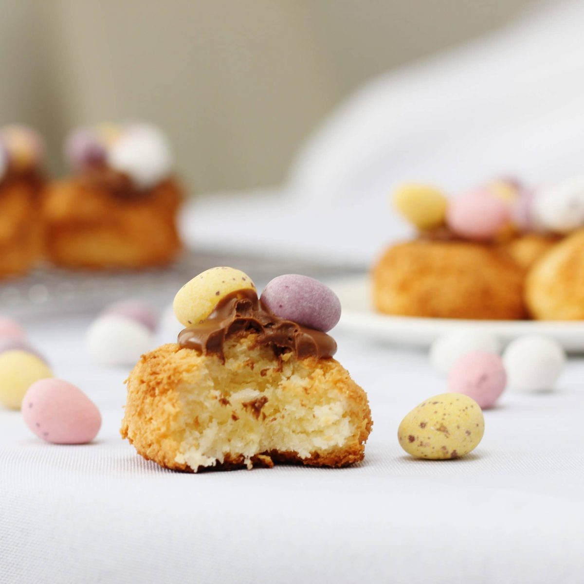 Coconut Macaroons topped with melted chocolate and mini eggs