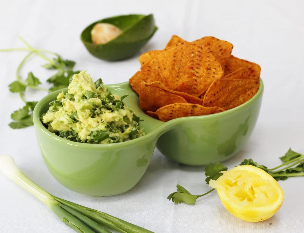 lemon and herb guacamole with tortilla chips