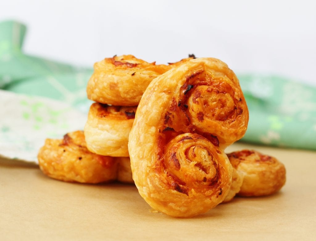 Cheesy chorizo pastries stacked up together