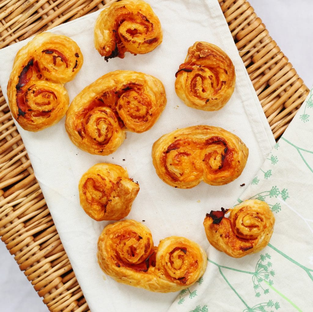 Cheesy chorizo pastries on a picnic basket