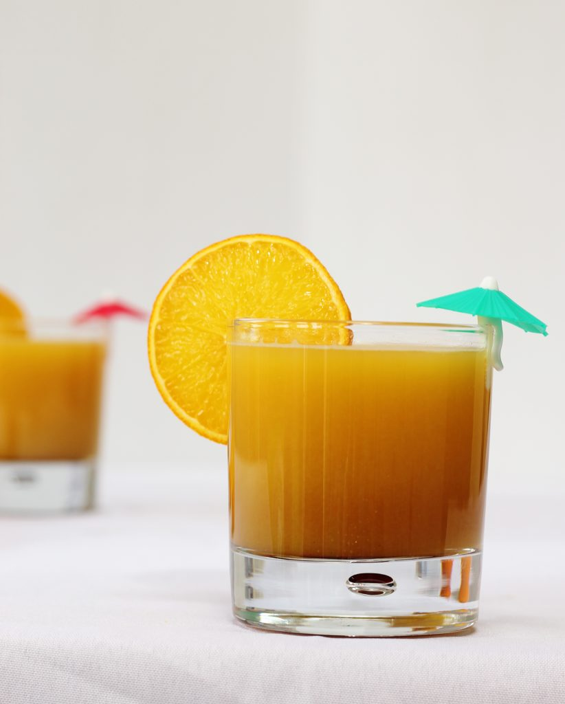 Orange and pomegranate molasses mocktail in a glass