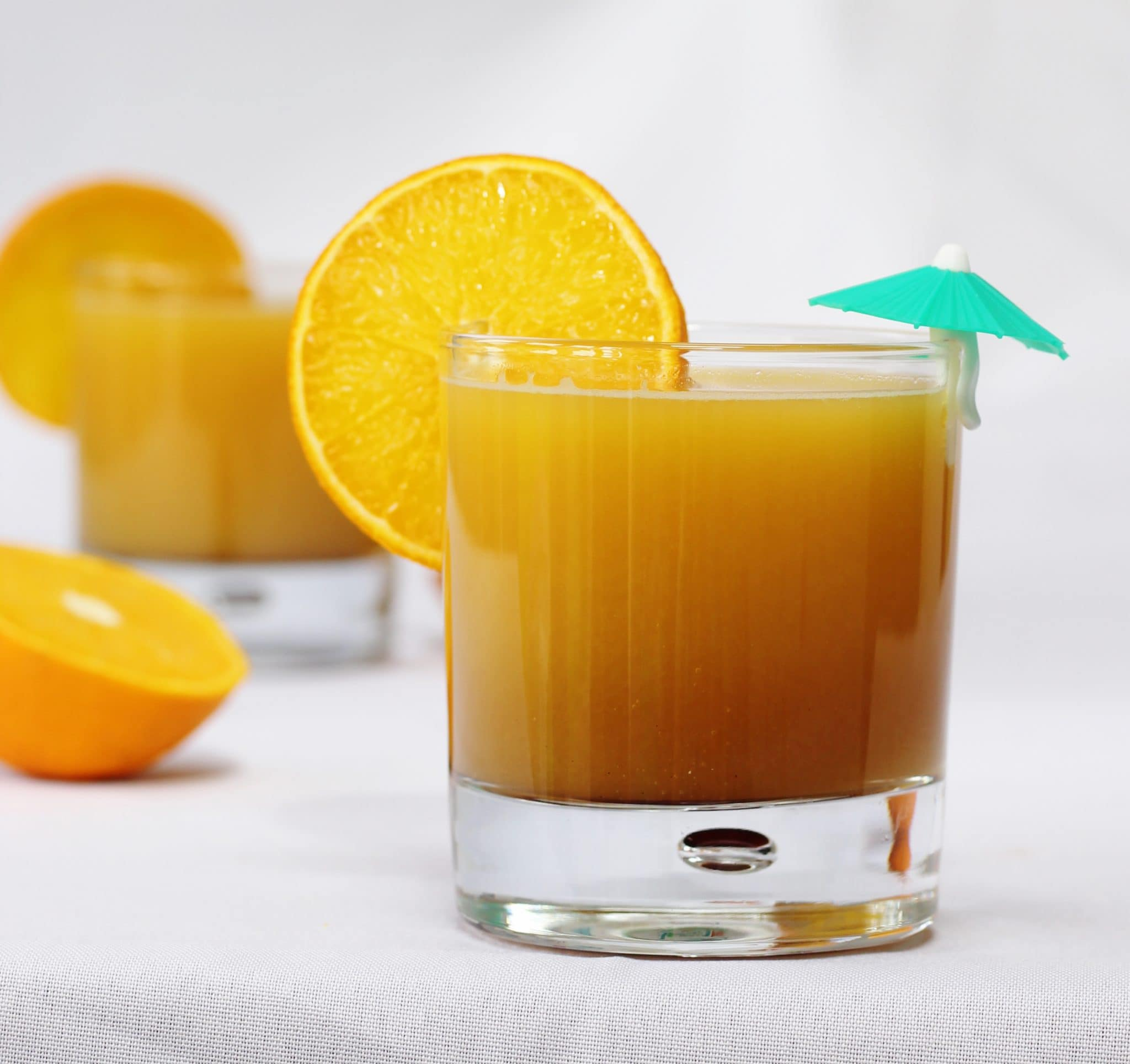 Glass of orange and pomegranate molasses mocktail