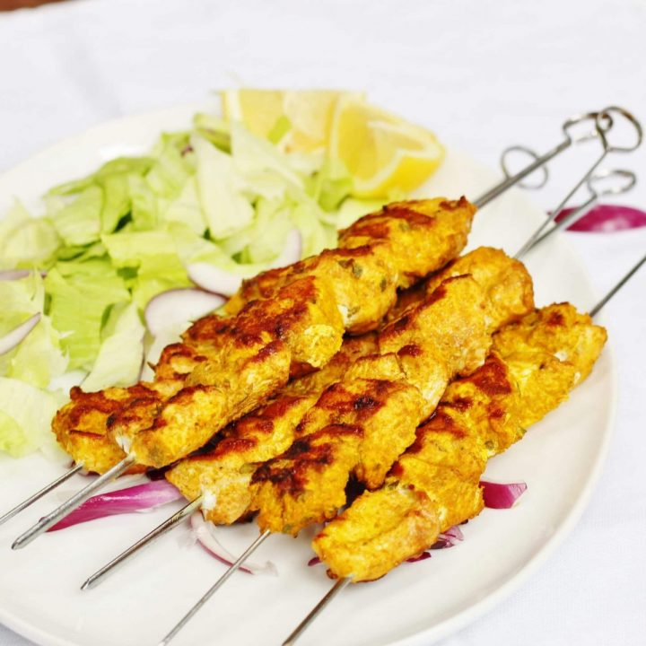 Spanish chicken kebabs with salad