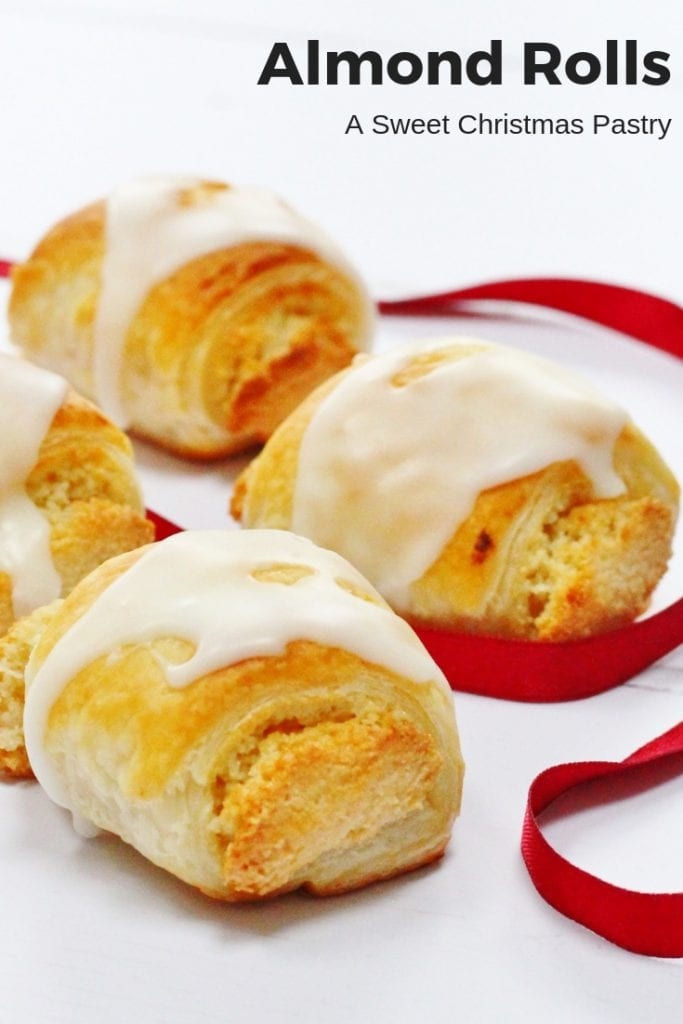 These almond rolls are the perfect Christmas pastry. Sweet homemade almond paste or marzipan wrapped in puff pastry and topped with a drizzle of icing. They're so addictive and an easy recipe to make too! #baking #christmas #almondpaste #puffpastry