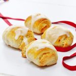 4 almond rolls with red ribbon
