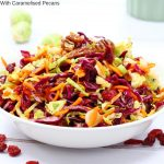 Crispy and crunchy, this brussel sprout coleslaw with caramelised pecans is so seasonal and tastes amazing!   If you haven't tried it yet, brussel sprouts are the perfect ingredient in a winter slaw. #brusselsprouts #coleslaw #wintersalad #healthyrecipe