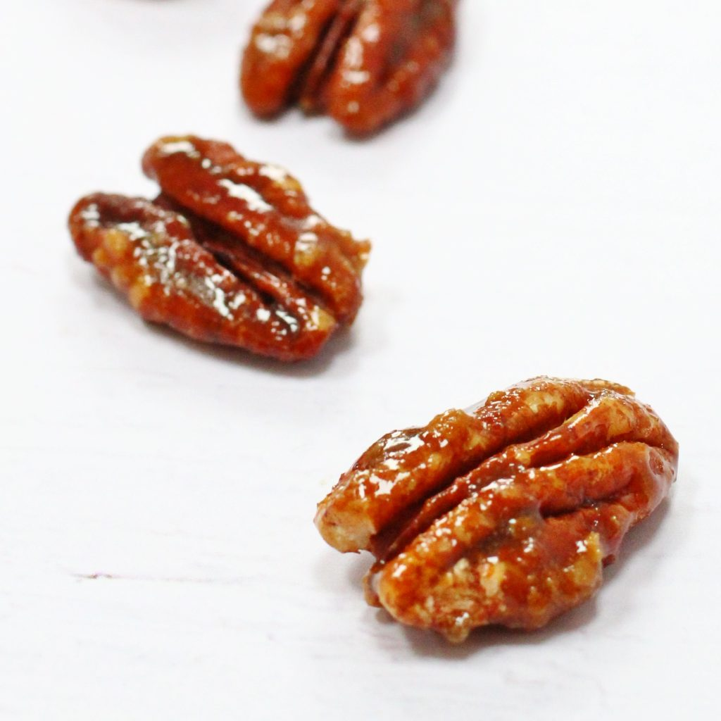 Three caramelised pecans