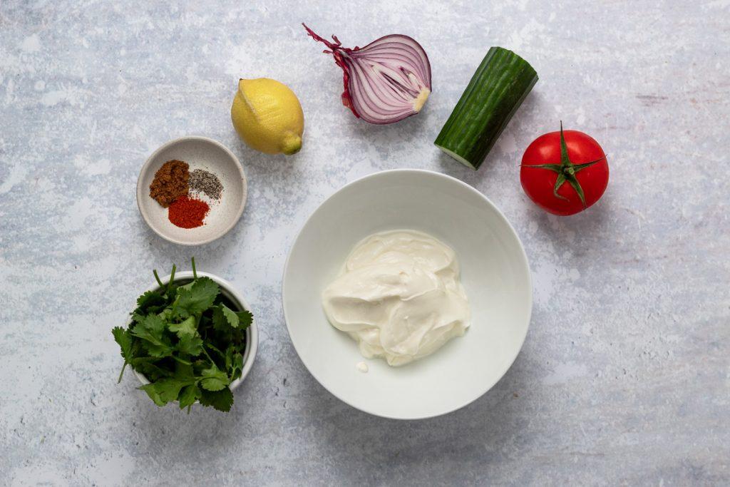 Ingredients for tomato cucumber and onion raita