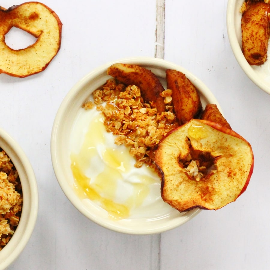 quark apple cinnamon breakfast bowl topped with honey and granola