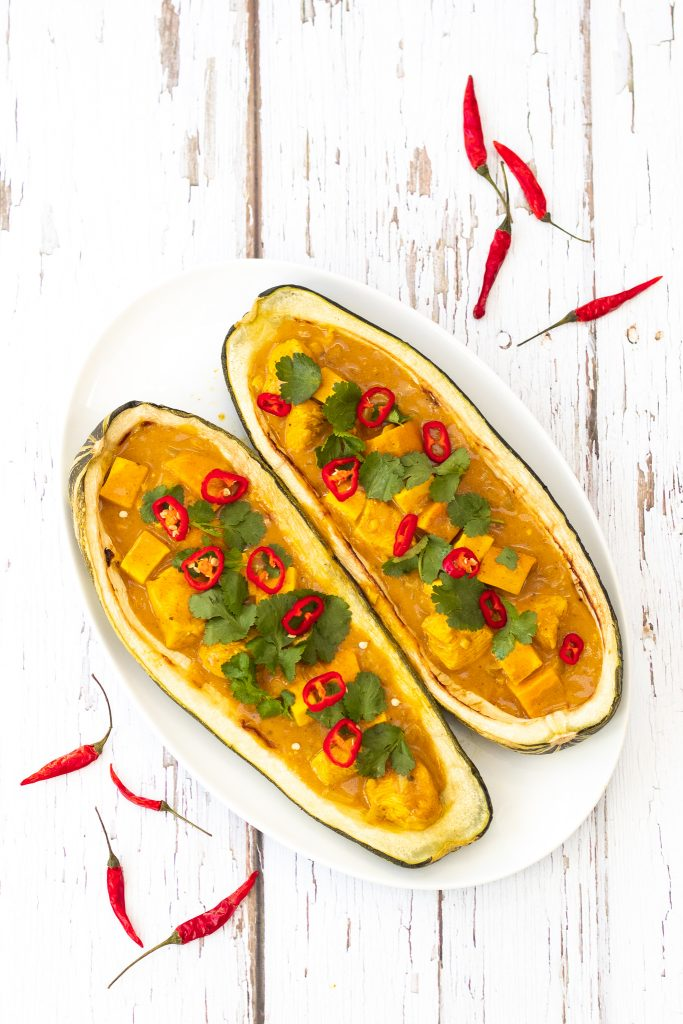 stuffed baked marrow with chicken curry topped with chillies and coriander