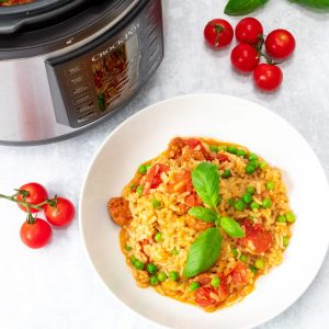 Crock Pot® Express Multi-Cooker with Chorizo risotto and cherry tomatoes