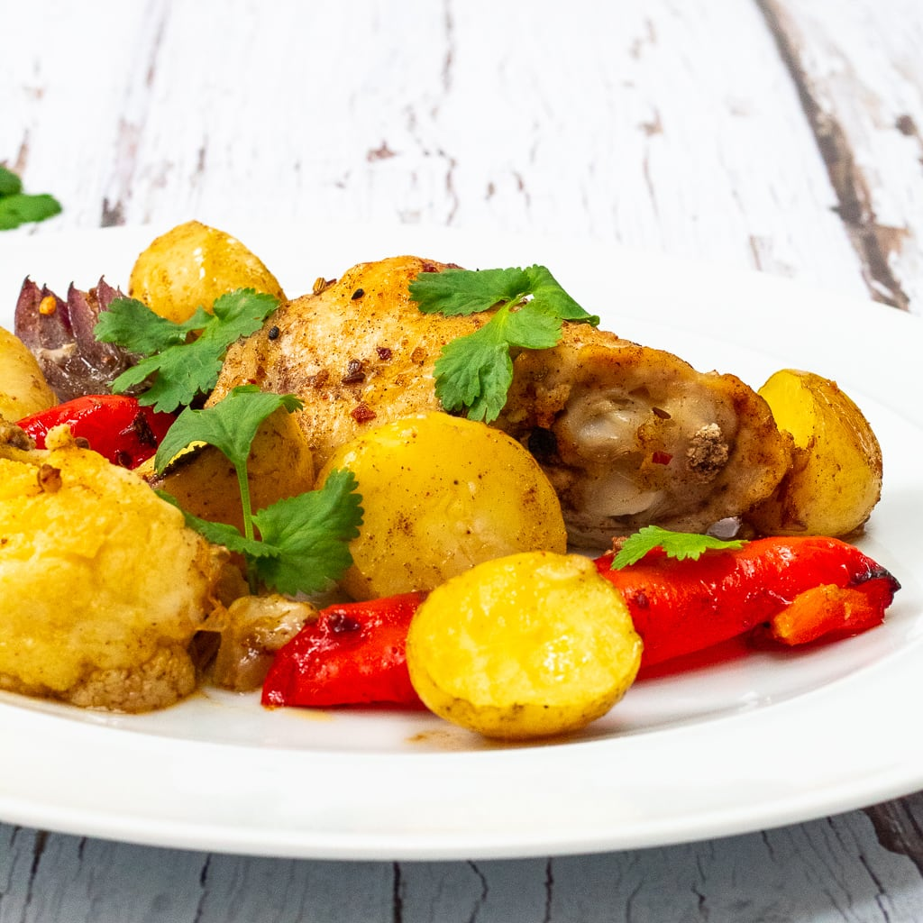 ras el hanout chicken, potatoes, peppers and cauliflower