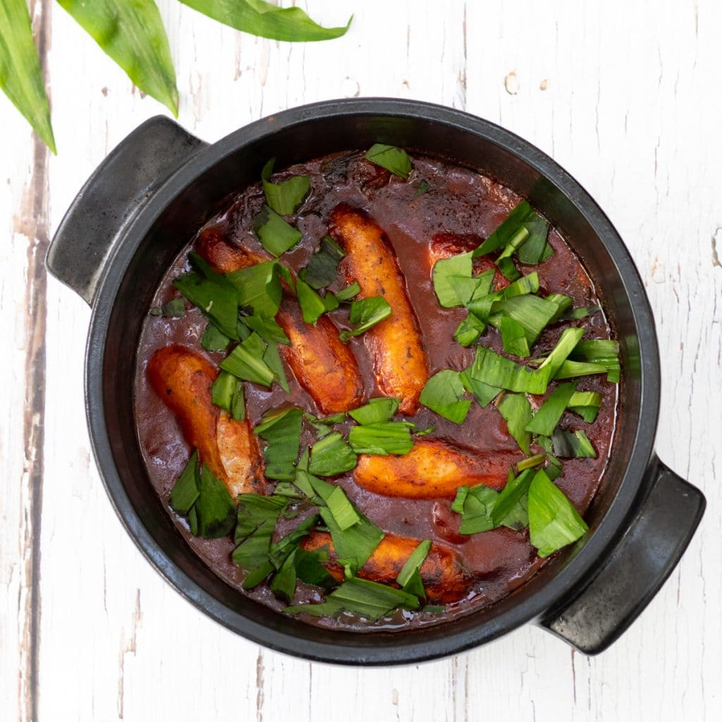 sausage and wild garlic stew in a pot