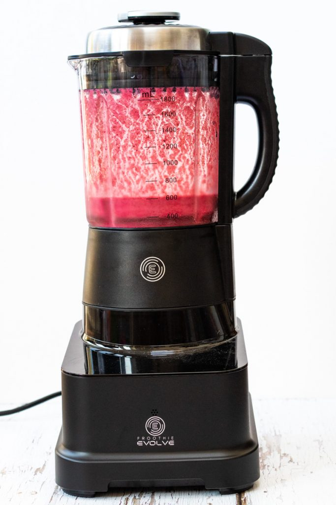 red berry smoothie in the Froothie Evolve high speed blender