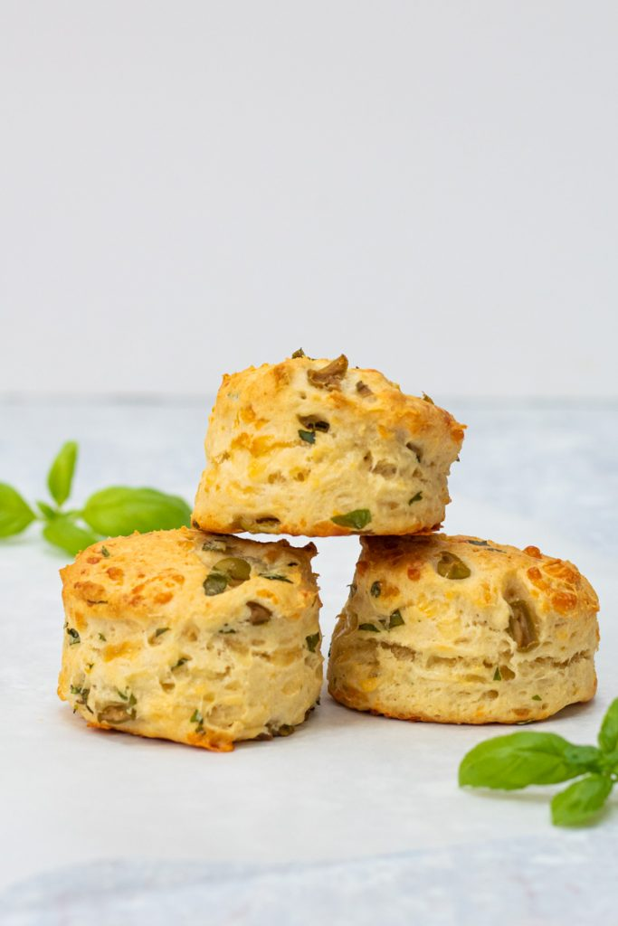 three cheese and olive scones stacked on top of each other