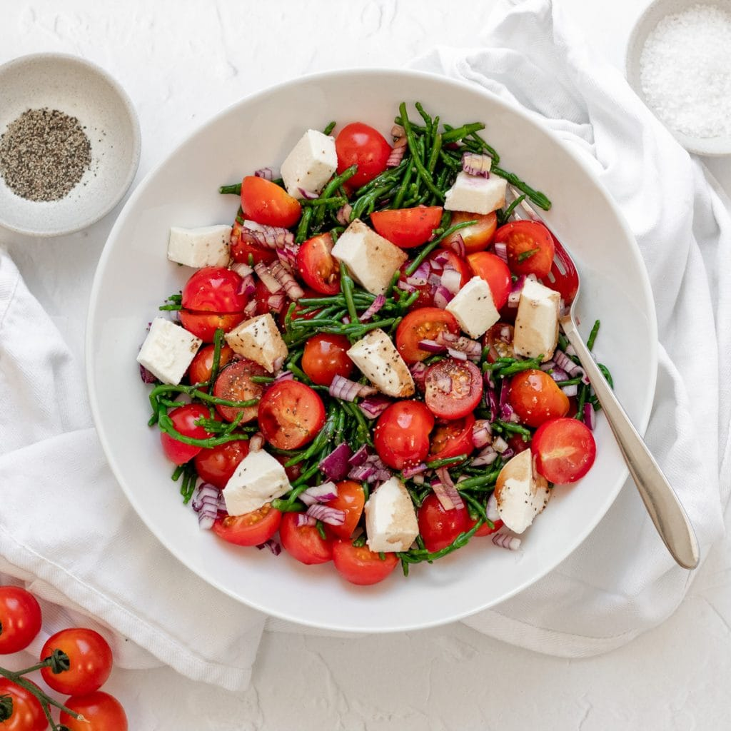 bowl of samphire salad with tomatoes and mozzarella