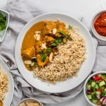 plate of chicken korma and rice