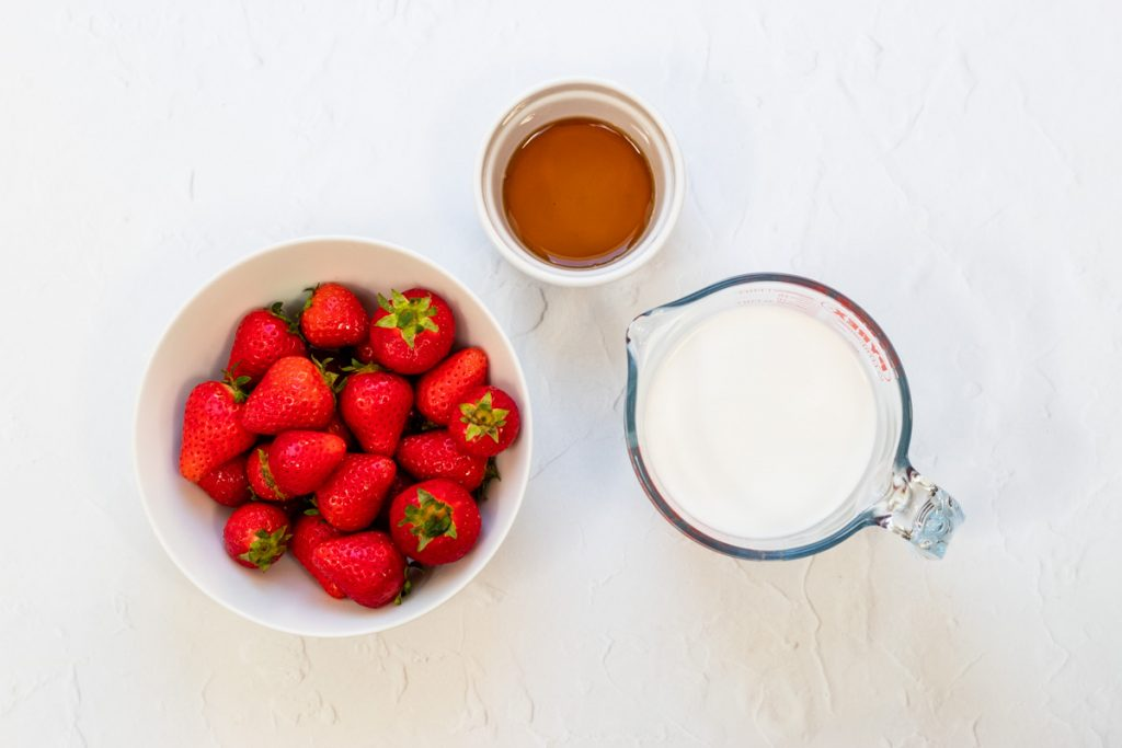 Ingredients for coconut milk strawberry ice lollies