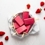 Bowl of strawberry coconut milk ice lollies