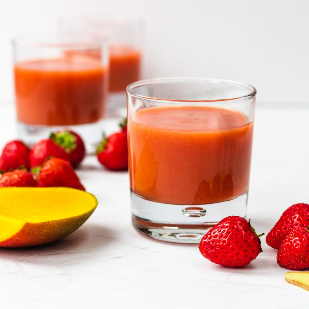 glass of strawberry mango smoothie with ginger