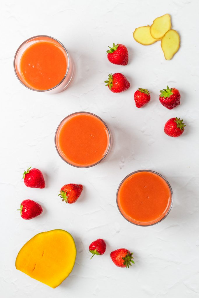 flatlay of strawberry mango smoothie with ingredients