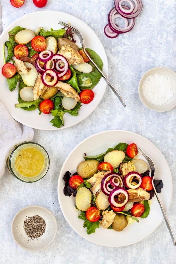 flatlay with two plates of potato and mackerel salad