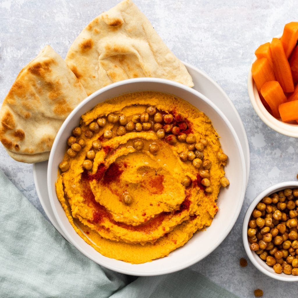 bowl of spicy roasted carrot hummus
